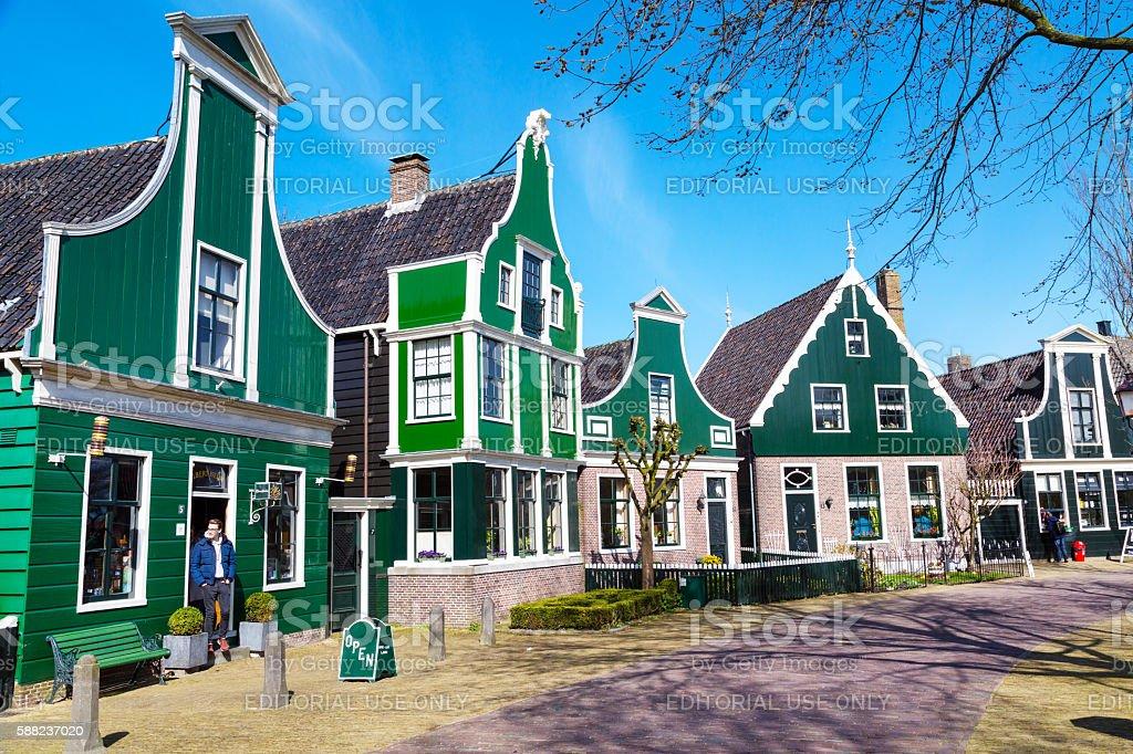 Zaanse Schans village, Holland, green houses against blue cloudy sky stock photo
