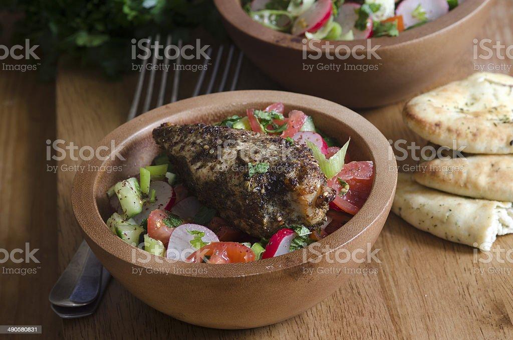 Za'atar chicken with fattoush stock photo