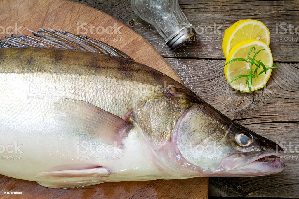 zander fish on the cutting board in the kitchen stock photo