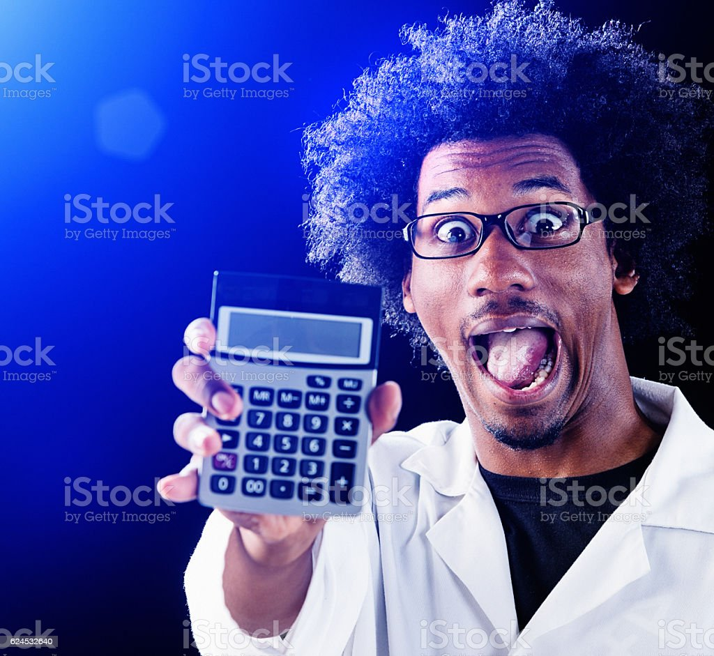 Zany scientist looks triumphant, holding up calculator stock photo