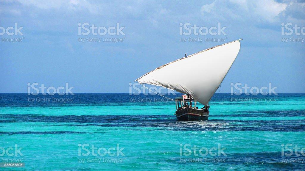 Zanzibar dhow local fisherman sailing boat blue turquoise sea Tanzania stock photo