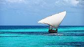 Zanzibar dhow local fisherman sailing boat blue turquoise sea Tanzania