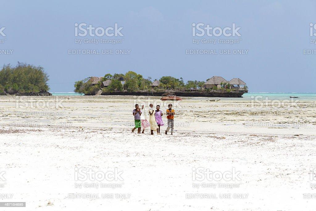 Zanzibarian Childrens walking on the beach stock photo