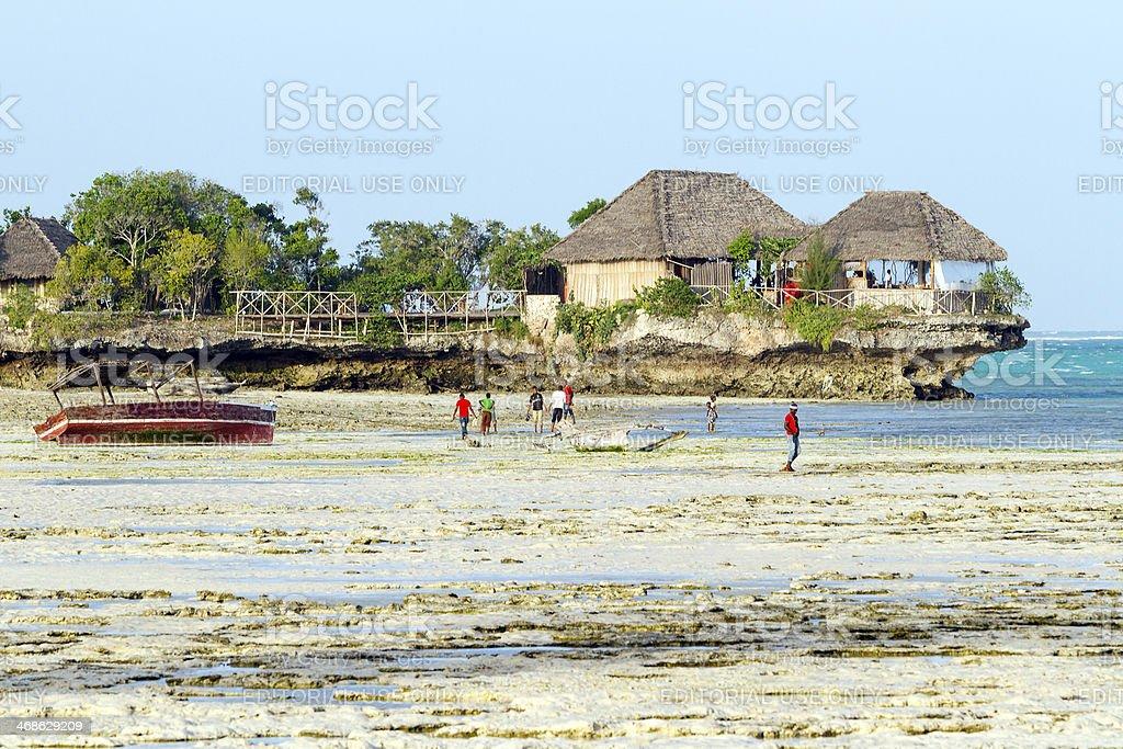 Zanzibarian's boys walking on the beach stock photo