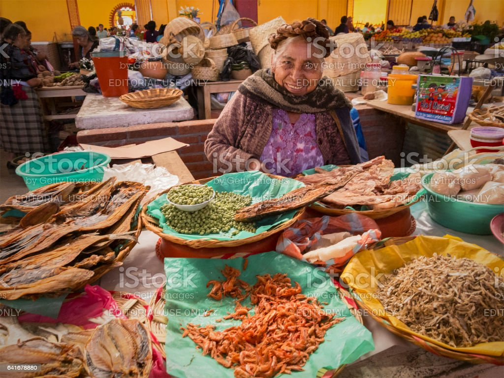 Zapotec woman selling dried seafood in market stock photo