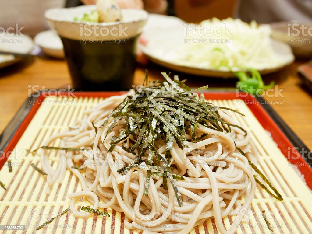 Zaru soba or cold soba noodles with seaweed on top stock photo