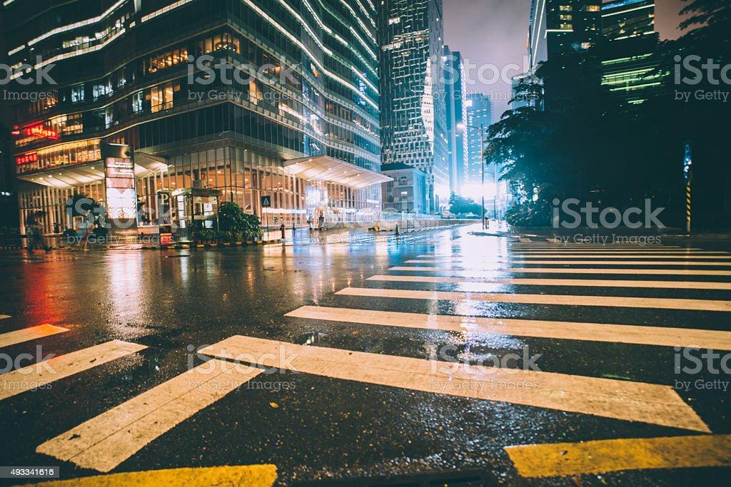 zebra cross of street at night stock photo