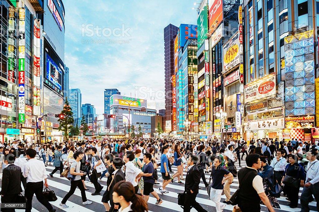 Zebra crossing in Shinjuku, Tokyo at sunset stock photo