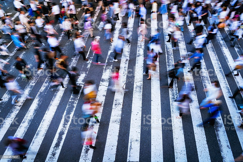zebra crossing in the Osaka, motion blurred people stock photo