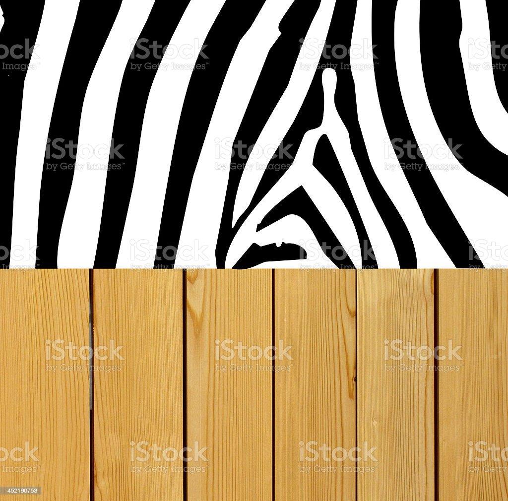 Zebra skin on wood background royalty-free stock photo