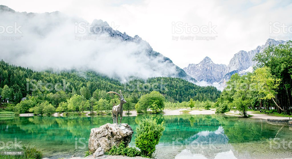 Zelenci pond and Julian Alps in Kranjska Gora, Slovenia stock photo