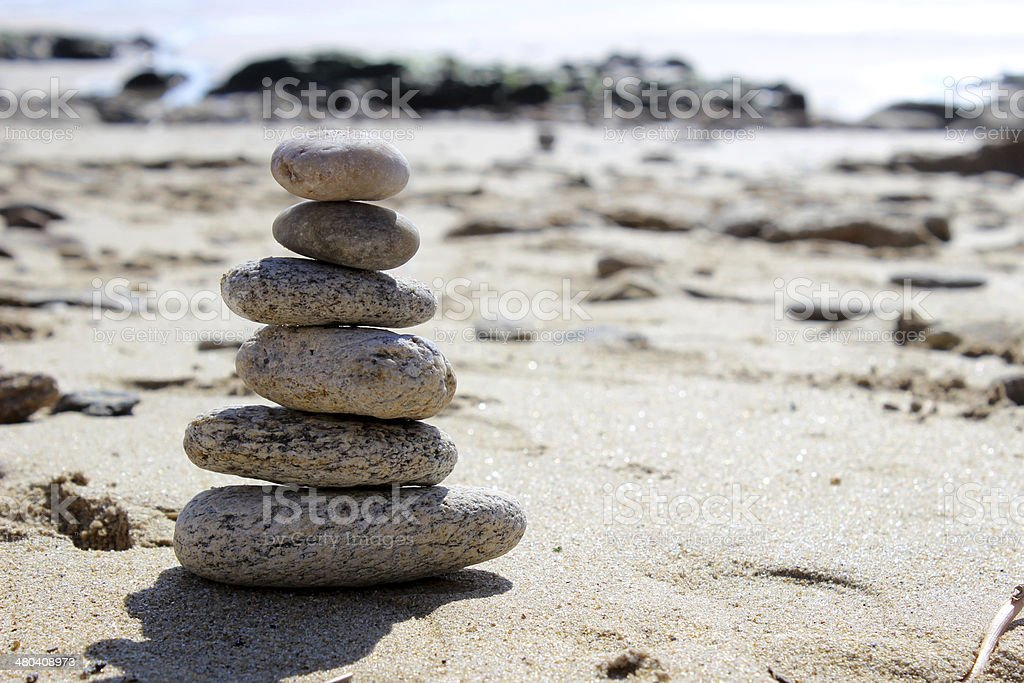 Zen balance stone on the beach 3 stock photo