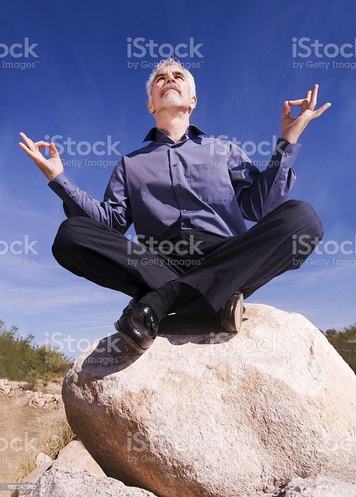 Zen Businessman in the Desert stock photo