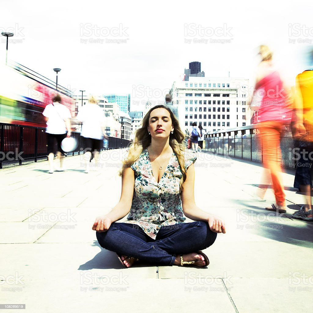 Zen contemplation on the busy streets of London stock photo