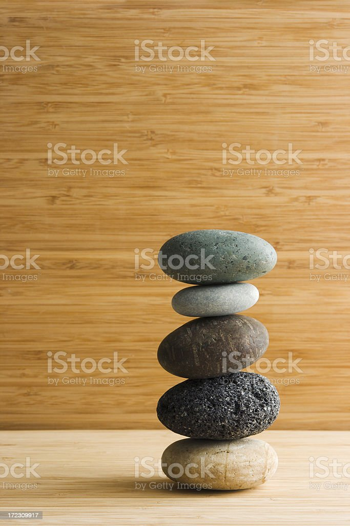 Zen Five Pebbles on Bamboo royalty-free stock photo
