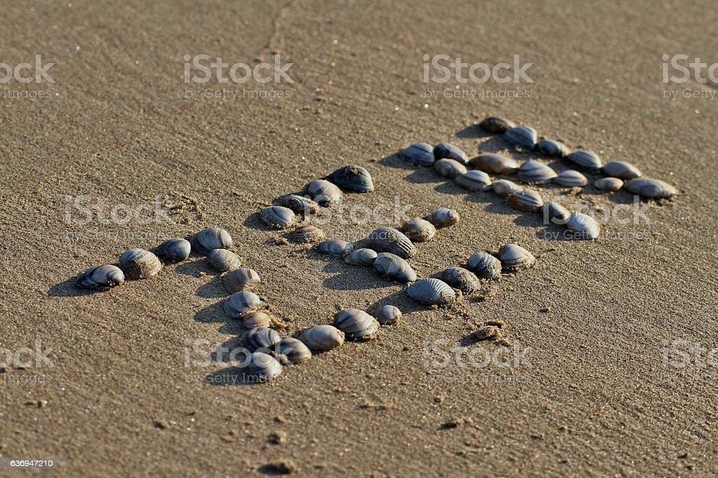 Zen mark on the beach stock photo