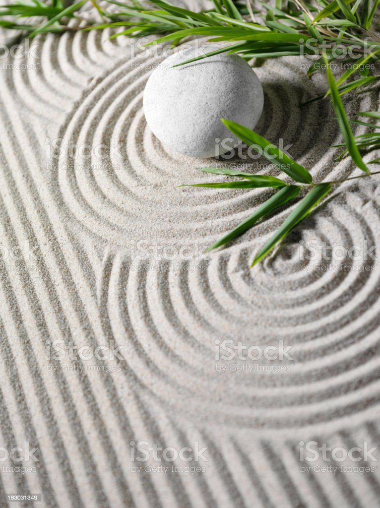 Zen Rock with Bamboo in Sand royalty-free stock photo
