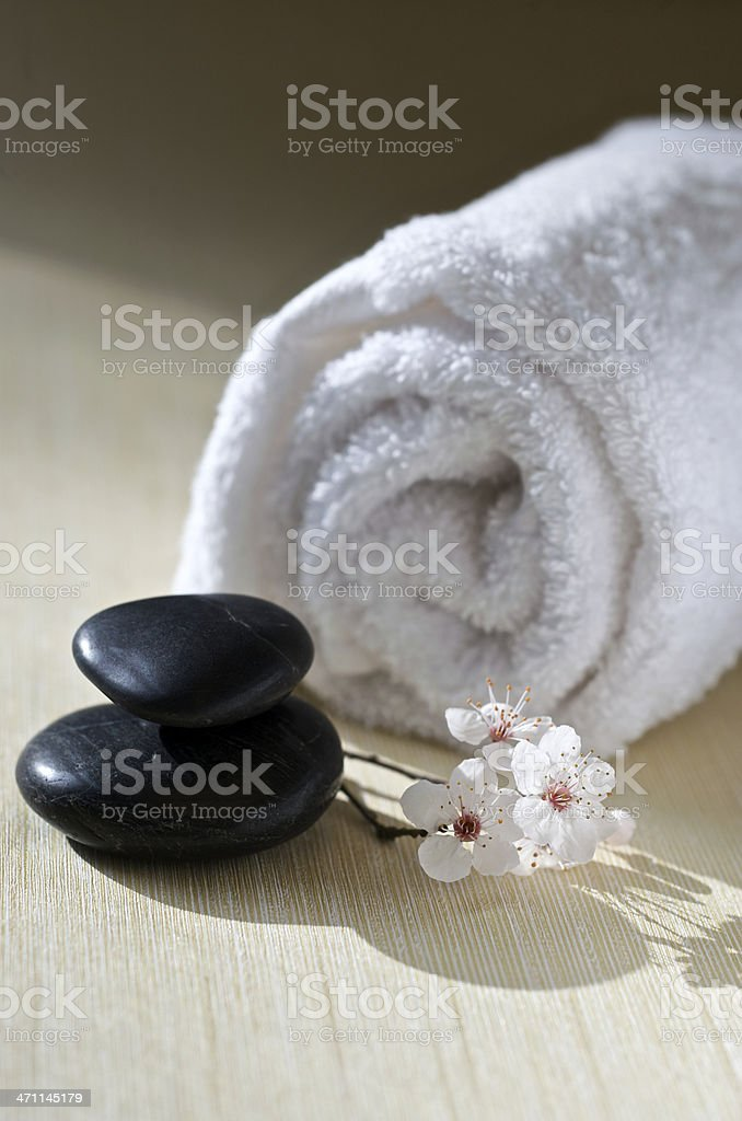 Zen Spa Concept with Cherry Blossoms, Massage Stones royalty-free stock photo