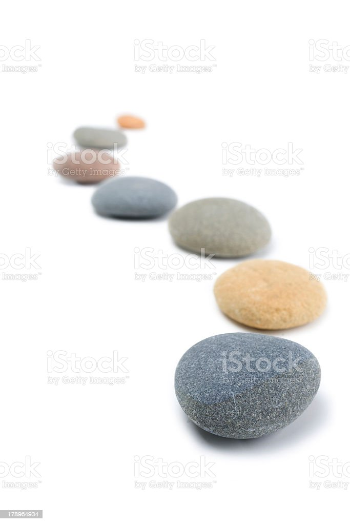 Zen stepping stones on a white back in a curved line stock photo