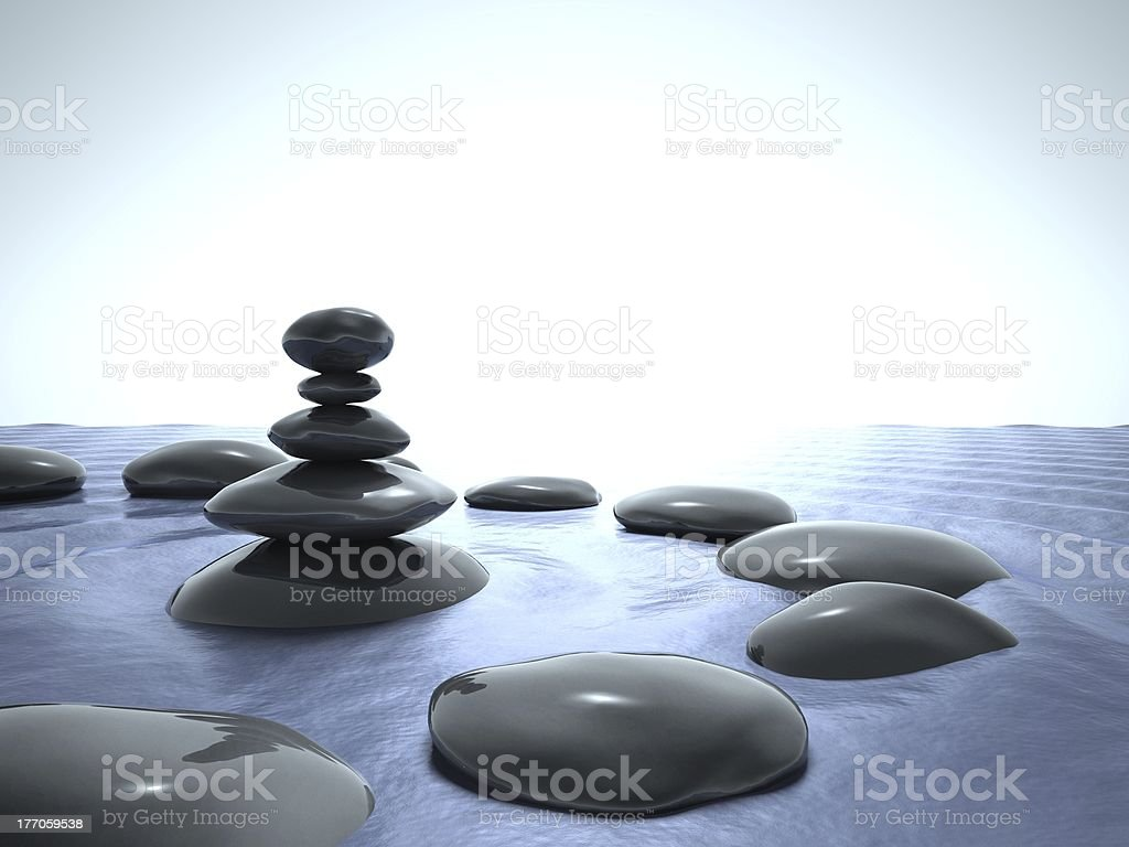 Zen stones in water, blue sky royalty-free stock photo