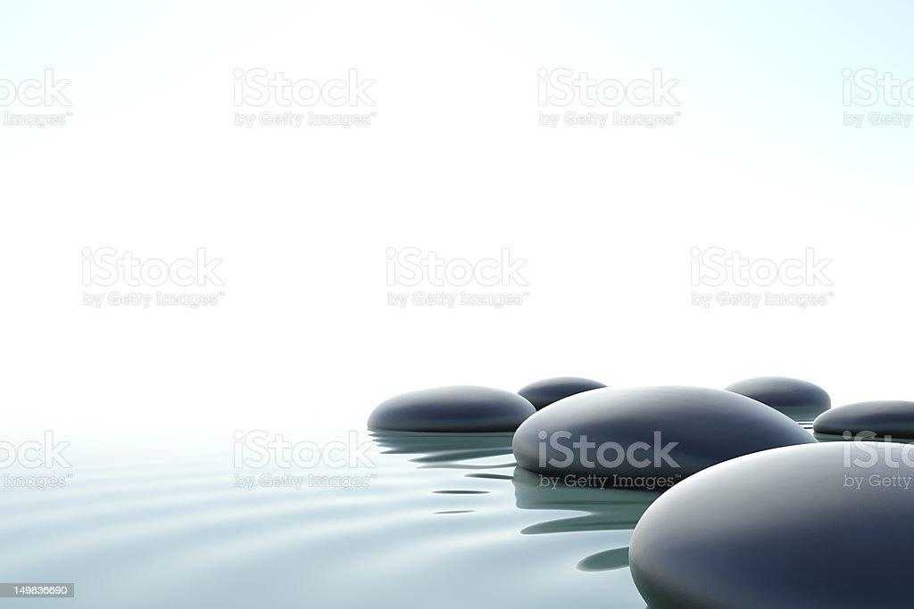 Zen stones in water stock photo