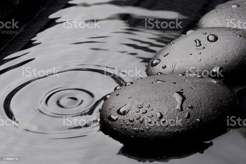 zen stones on wet background stock photo
