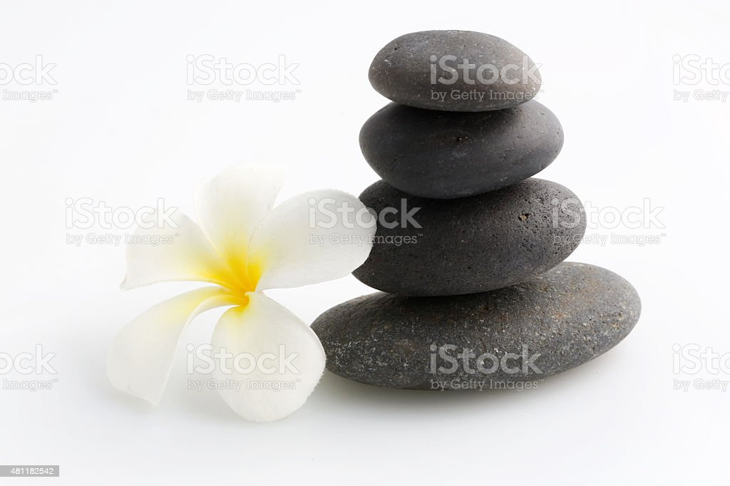 Zen stones with frangipani flower stock photo