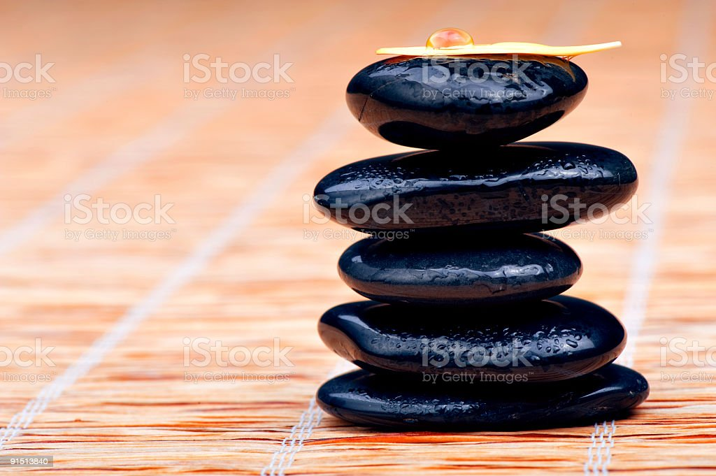 Zen stones with water and petal royalty-free stock photo