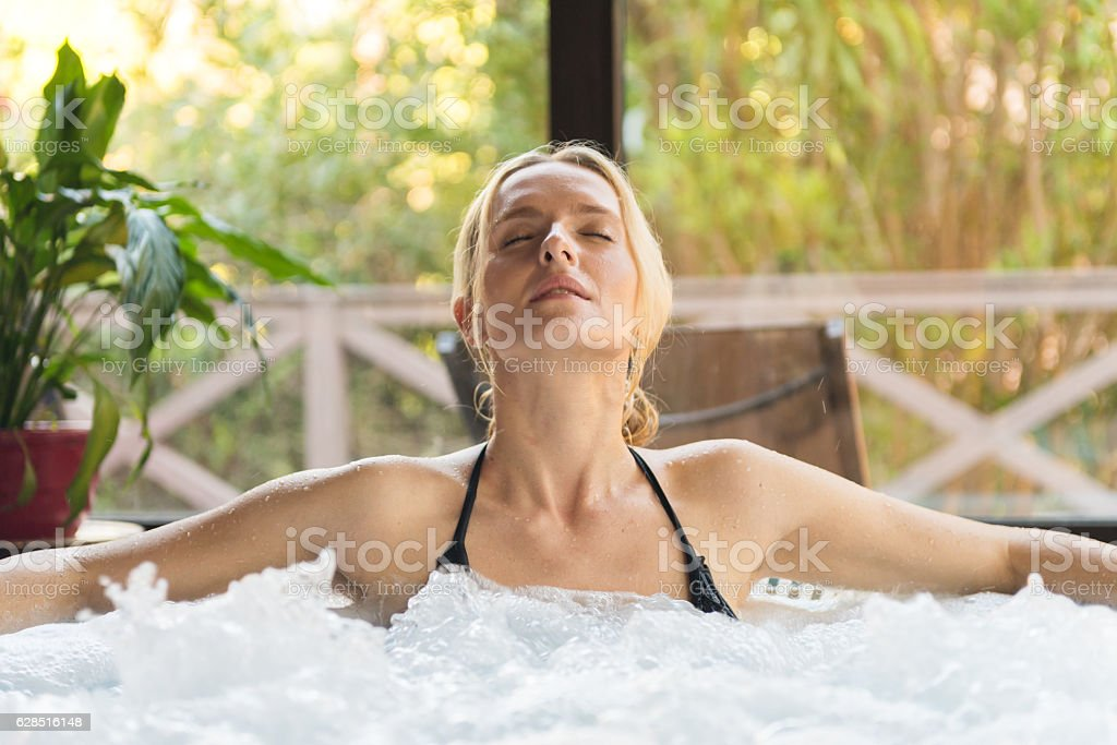 Zen-like in jacuzzi stock photo