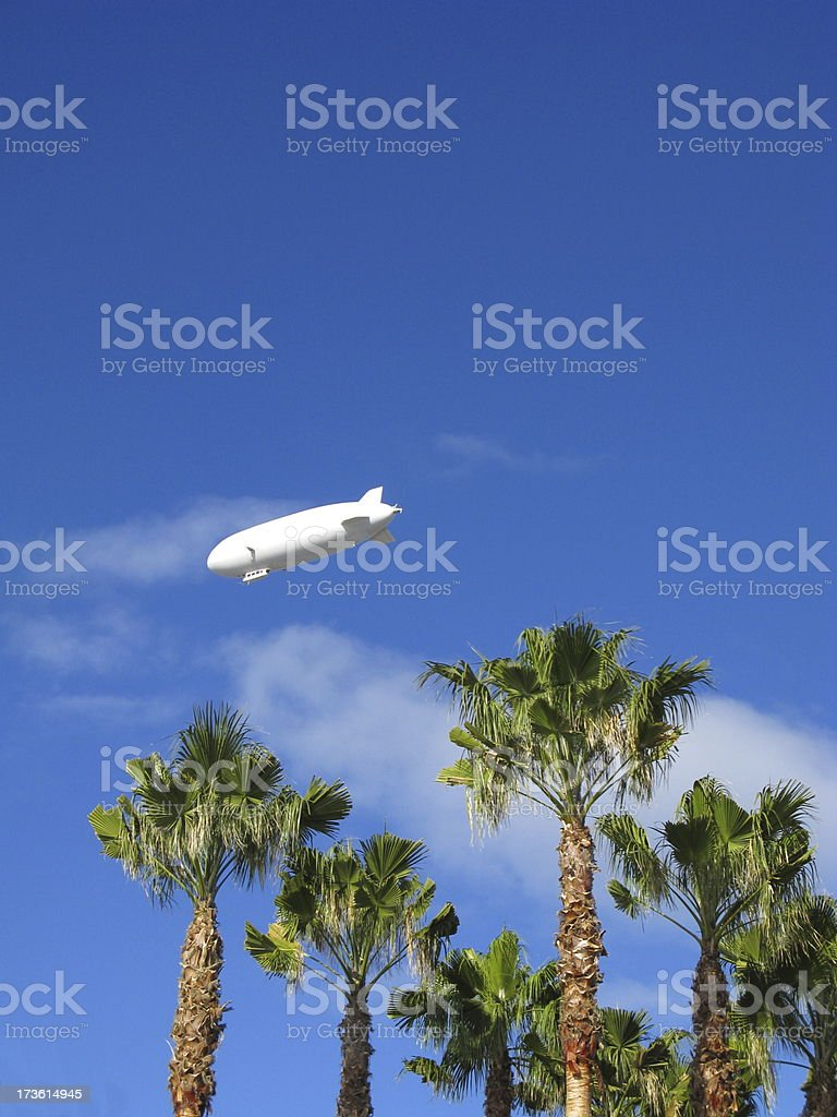 Zeppelin Over Palm Trees stock photo