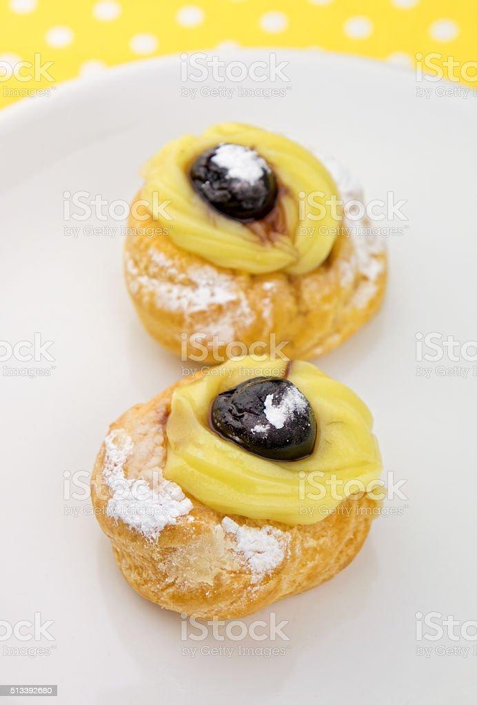 Zeppole - italian pastries on white plate stock photo