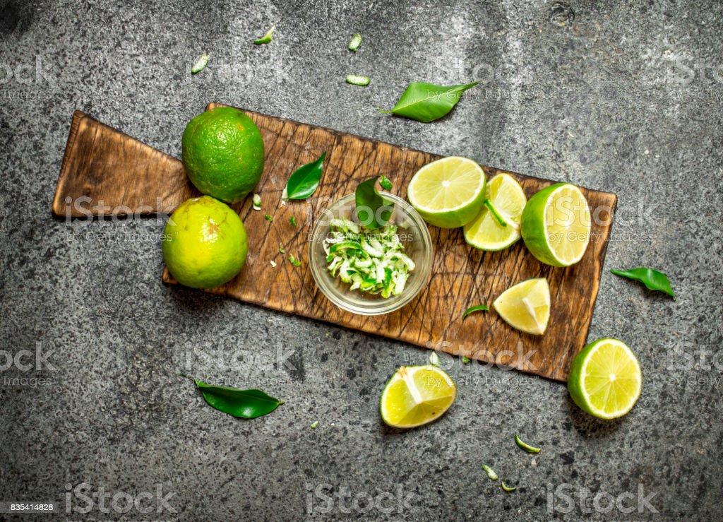 Zest lime slices on the old Board. stock photo