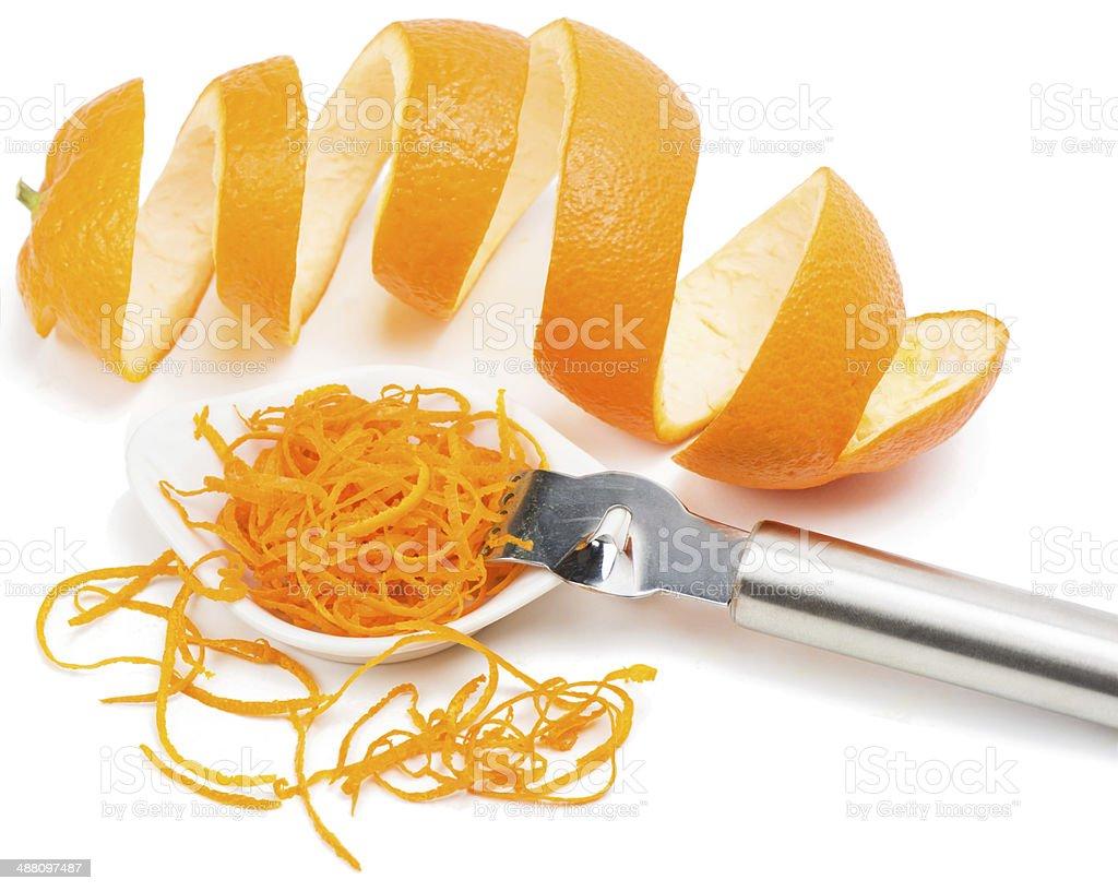 zest  of orange fruit and zester stock photo