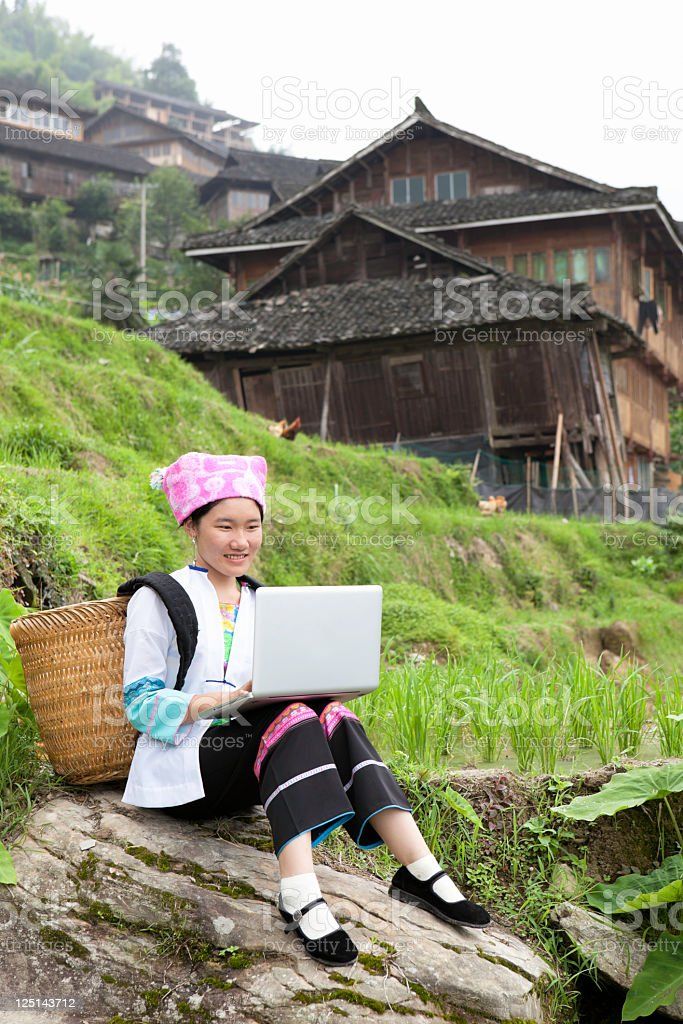 Zhuang Minority Girl Using The Laptop royalty-free stock photo