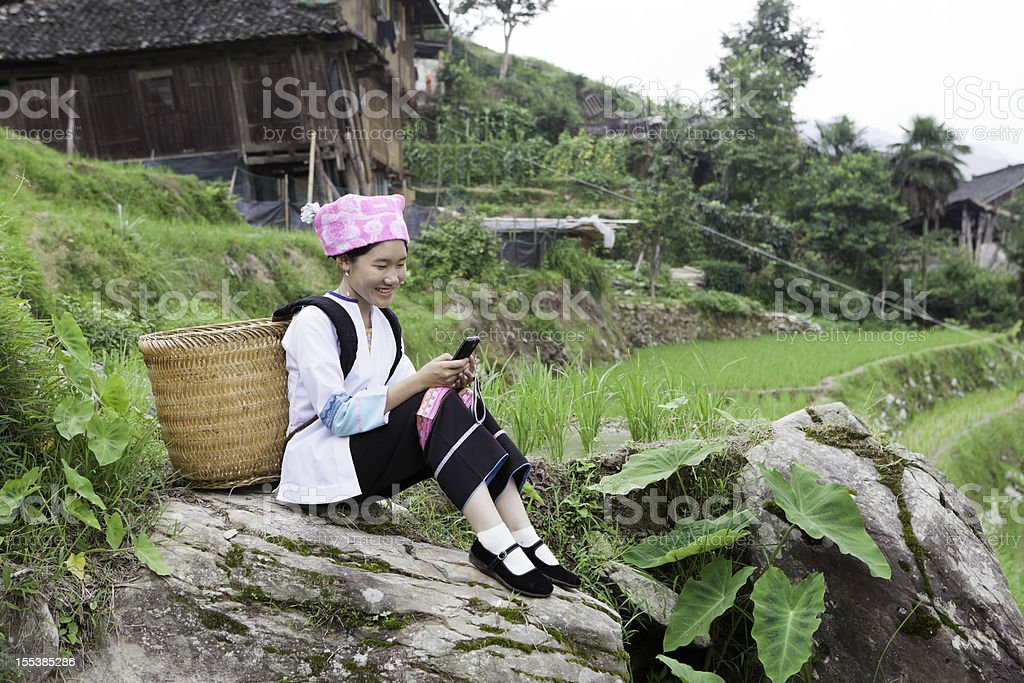 Zhuang Tribe Girl Text Messaging stock photo