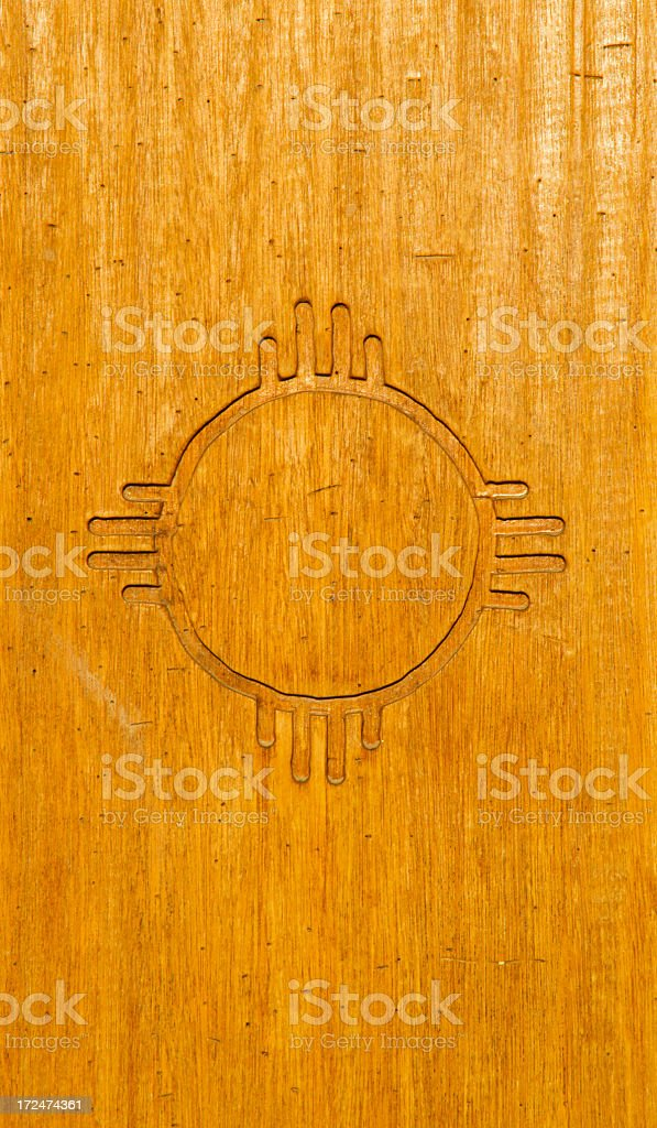 Zia Sun symbol on Wood stock photo