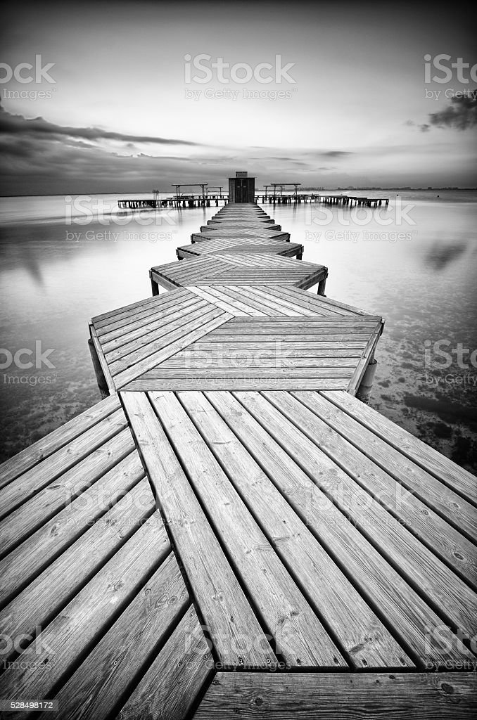 Zig Zag dock at sunrise in black and white stock photo
