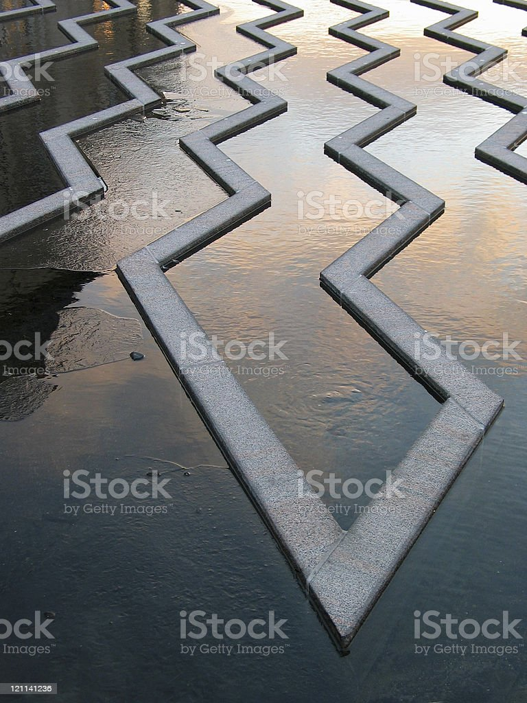 Zigzag in fountain and frozen water royalty-free stock photo