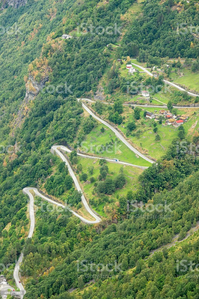 zig-zag winding road going up a steep slope stock photo