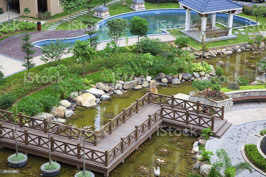 Zig-zag wooden bridge and pavilion royalty-free stock photo