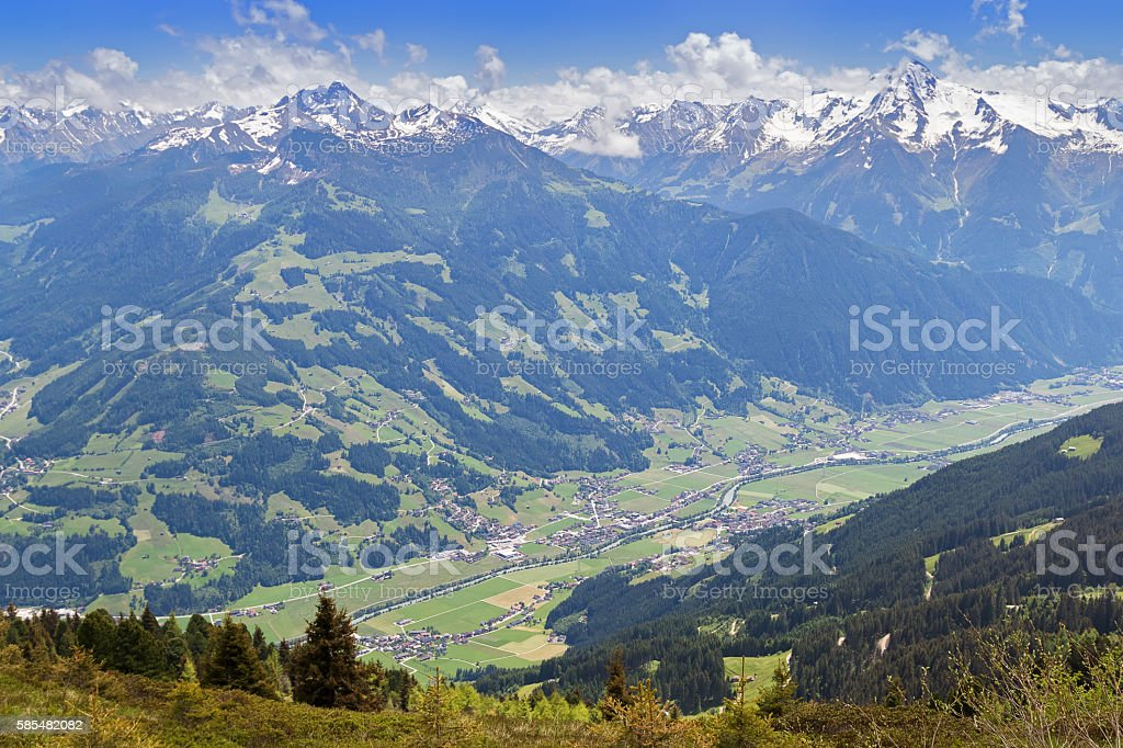 Zillertal valley village surrounded by mountains with snow during summer stock photo