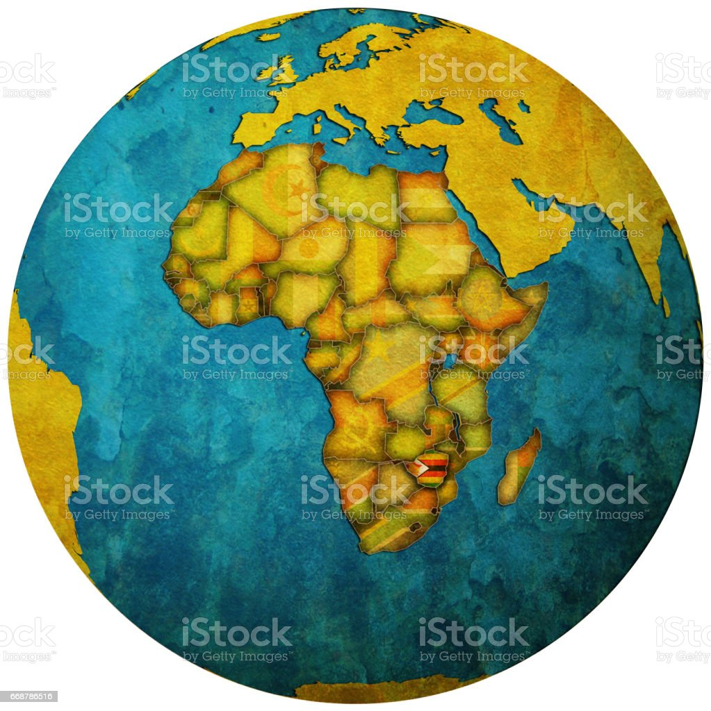 zimbabwe territory with flag on map of globe stock photo