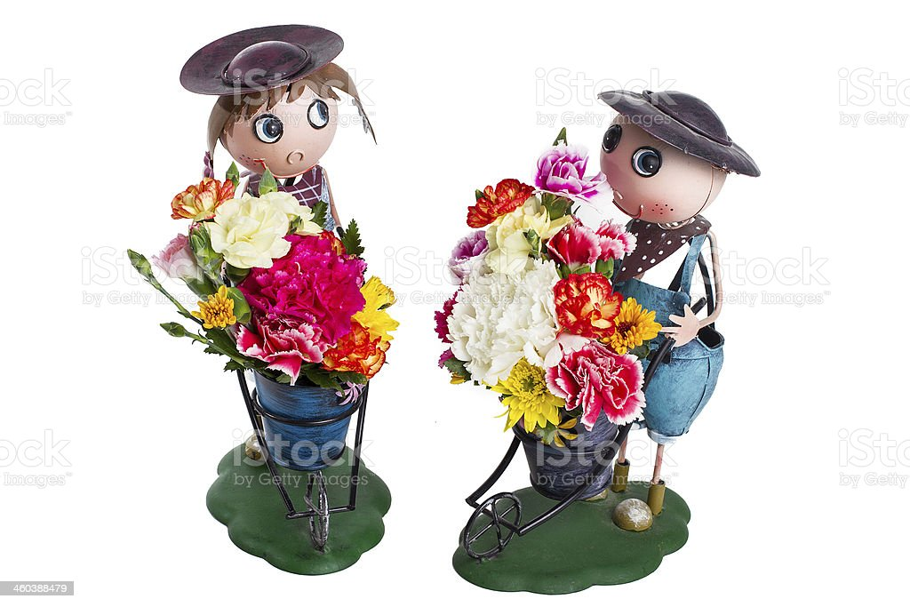 zinc doll with colorful flower royalty-free stock photo