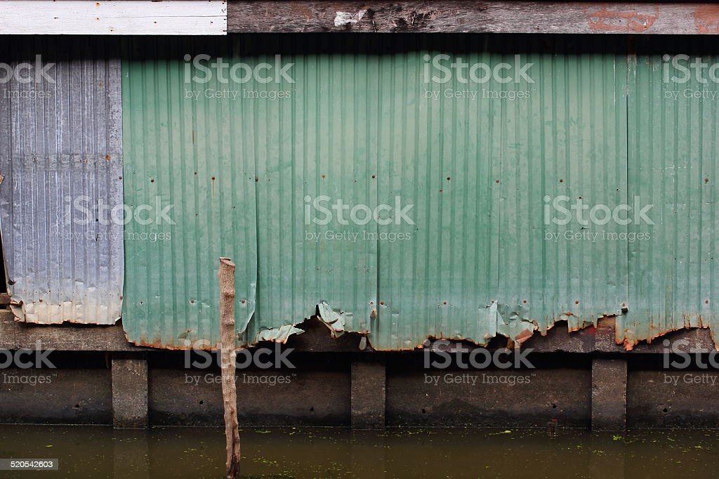 Zinc Fence old canal stock photo