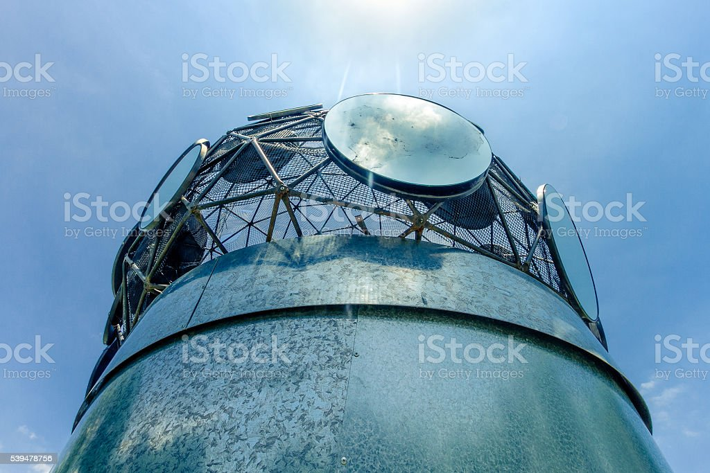 Zinc plate cylinder with round backlit mirrors stock photo