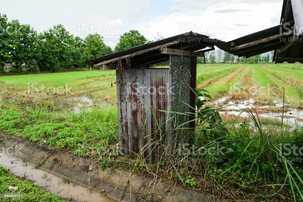 Zinc rest room in the countryside. stock photo