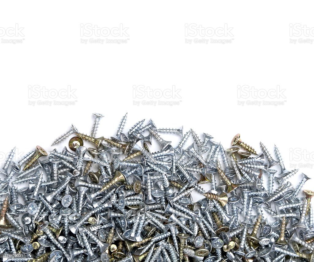 Zinked and anodized screws. Half background. royalty-free stock photo