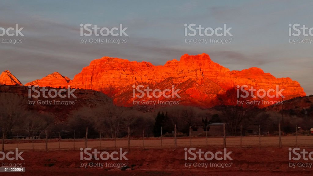 Zion peaks glowing from red sunset near Rockville Utah stock photo