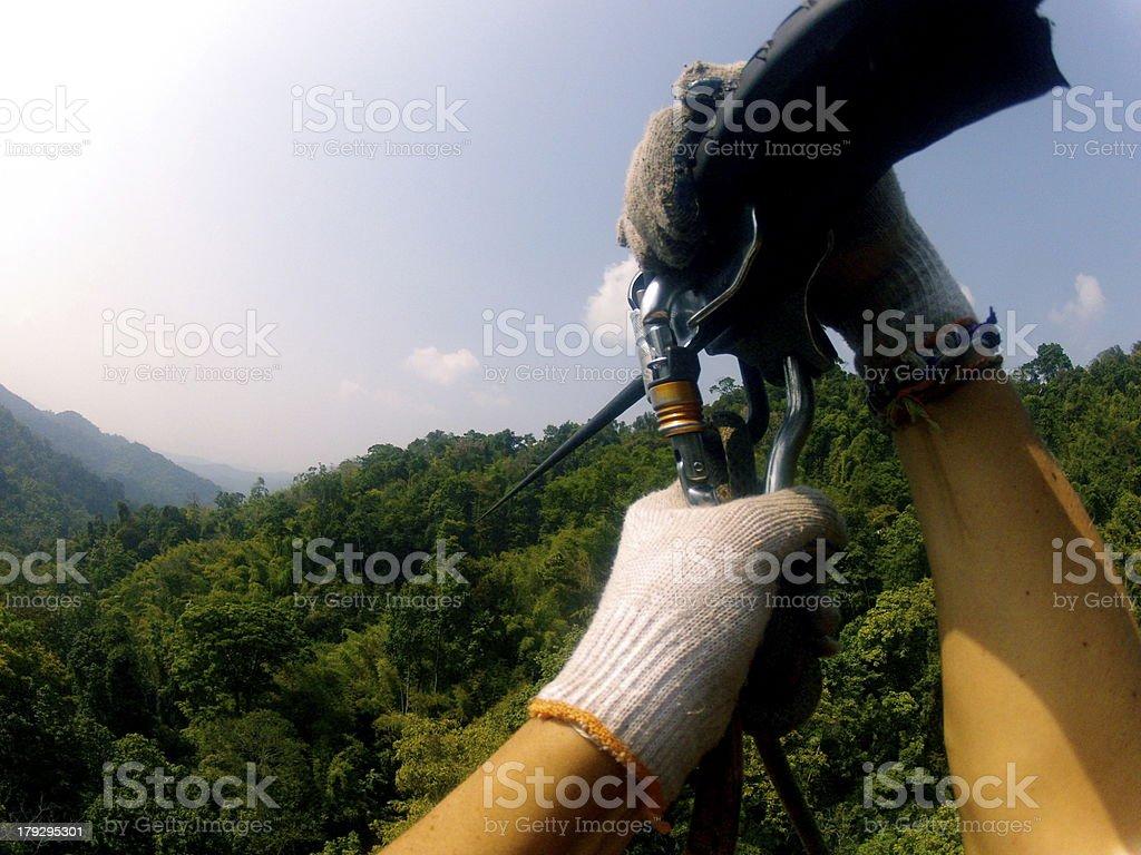 Zip lining hands stock photo