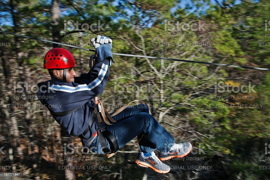 Ziplining through the forest stock photo